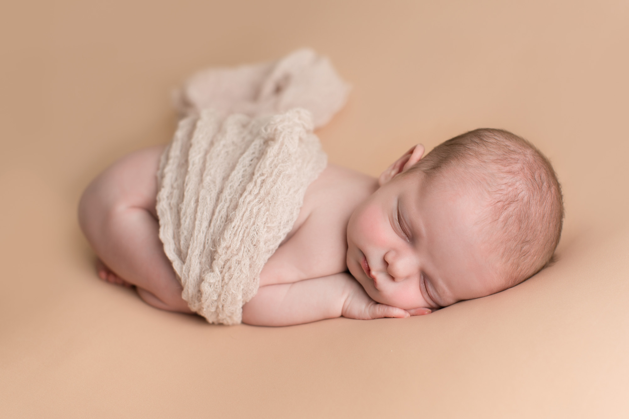 Newborn girl laying on pink taken by DMV newborn photographer Sarah Botta Photography in Woodbridge, VA studio