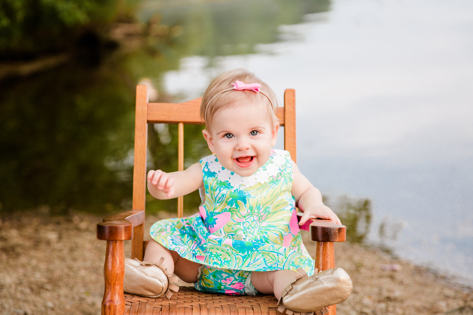 One year outdoor session with little 1 year wearing Lily Pulitzer sitting on rocking chair taken by DMV newborn photographer Sarah Botta Photography in Woodbridge, VA