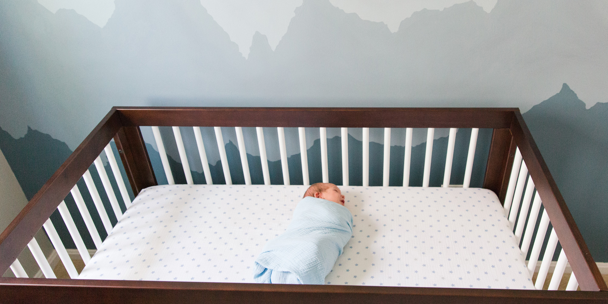 Newborn boy laying in crib taken by DMV newborn photographer Sarah Botta Photography